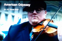 Screencap of street violinist in American Odyssey